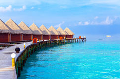 Maldives. A wooden road over ocean Royalty Free Stock Images