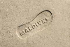 Maldives written into sand  background Stock Photos
