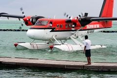 Maldivian Air Taxi. Lining up to dock and drop off passengers Royalty Free Stock Photos