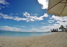 Maldivian beach. Maafushivaru island, Ari Atoll, beach umbrella. Maldives Royalty Free Stock Photography