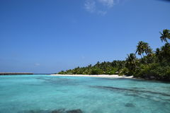 Maldivian beach with overwater-bungalows Royalty Free Stock Photos