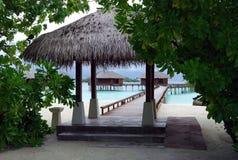 Maldivian beach. The way to the waterbungalows, Maldives royalty free stock photo