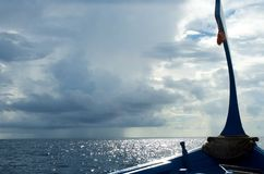 Maldivian boat on the ocean in an overcast day Stock Images