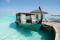 Maldivian boats. Boat anchored on clean blue maldivian water stock image
