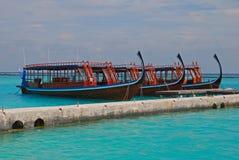 Maldivian Dhoni Cruises. Docking at Pier outside a Luxury Resort Stock Photos