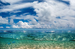 Maldivian Dream Paradise. Indian ocean half water shoot. Daylight in Sky and underwater shallow sandy bottom discovered stock image