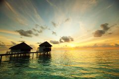 Maldivian houses on sunrise Stock Photos