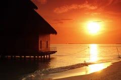 Maldivian houses on sunrise Stock Image