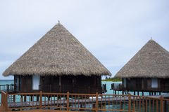 Maldivian  overwater bungalows and tourquise clear water Royalty Free Stock Photography