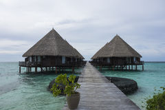 Maldivian  overwater bungalows and tourquise clear water Royalty Free Stock Image