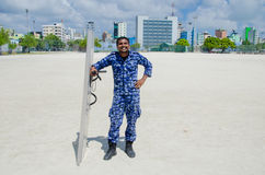 Maldivian police officer  with shield and baton Stock Photos