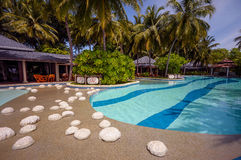 Maldivian resort pool side. Maldivian resort with view to the pool side and open restaurant Royalty Free Stock Image