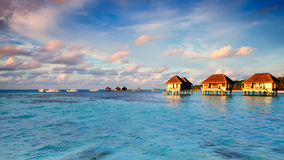 Maldivian water bungalows. With blue sky and sea stock images