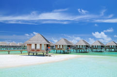 Maldivian water bungalows. With blue sky and sea stock photos