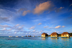 Maldivian water bungalows. With blue sky and sea royalty free stock photography