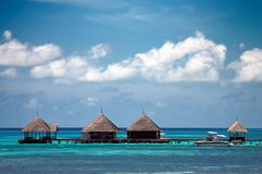 Maldivian water bungalows. With blue sky and sea stock photography