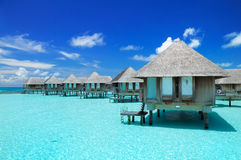 Maldivian water bungalows. With blue sky and sea royalty free stock image