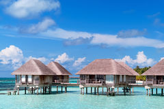Maldivian water bungalows. With blue sky and sea royalty free stock images