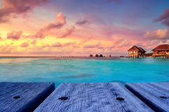 Maldivian water bungalows at dusk Stock Photography