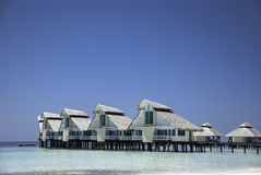 Maldivian Waterhuts. Ellaidhoo Island waterhuts area in a lovely lagoon Royalty Free Stock Image