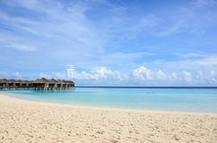 Maldivian white beach. White sand beach and water villas on Maafushivaru island, Ari Atoll, Maldives Royalty Free Stock Photography