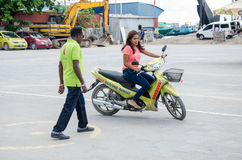 Maldivian women learn how to drive motorbike at driving school Royalty Free Stock Image