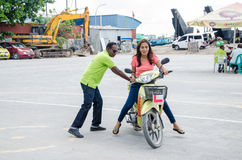 Maldivian women learn how to drive motorbike at driving school Stock Photos