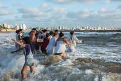 Parishioners of the Umbandist church worship Orisha Yemanja Iemanja on the Playa Mansa beach in Punta del Este stock photography
