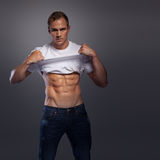 Male with abs lifting shirt up Stock Photos