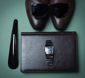 Male accessories. Shoes and watch Royalty Free Stock Photography