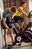 Male adapt bike for exercising. Male adapt exercise bike in gym Stock Photography