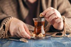 Male add sugar in hot tea Stock Photos