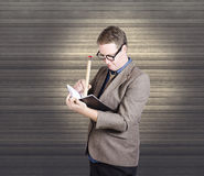 Male administration clerk writing diary notes Royalty Free Stock Image