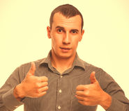 Male adult brunette man shows sign gesture with both hands so on Stock Photos