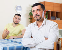 Male adults arguing about something. Portrait of two despair male adults arguing about something indoors after quarrel Royalty Free Stock Photo