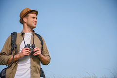 Male adventurer hiking on meadow Stock Image
