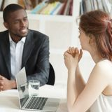 Male african american and female caucasian negotiating at briefi stock photos