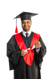 Male african american graduate in gown and cap Royalty Free Stock Photo