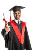 Male african american graduate in gown and cap Stock Photos