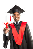 Male african american graduate in gown and cap Royalty Free Stock Images