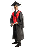 Male african american graduate in gown and cap Stock Photo