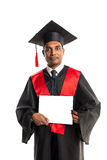 Male african american graduate in gown and cap Royalty Free Stock Photos