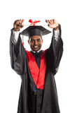 Male african american graduate in gown and cap Royalty Free Stock Image