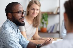 Male african-american talking to coworkers timeout in office stock photography