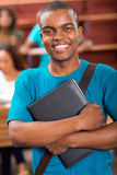 Male african college student. Cheerful male african college student portrait in lecture room Stock Photography