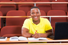 Male african college student. Happy male african american college student in lecture room Stock Photography