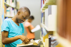 Male african college student reading Royalty Free Stock Image