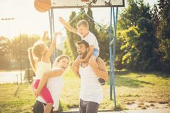 Male against female. Family playing basketball royalty free stock photo