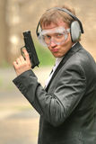 Male agent with gun Royalty Free Stock Photography