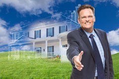 Male Agent Reaching for Hand Shake in Front of Ghosted New House Stock Image